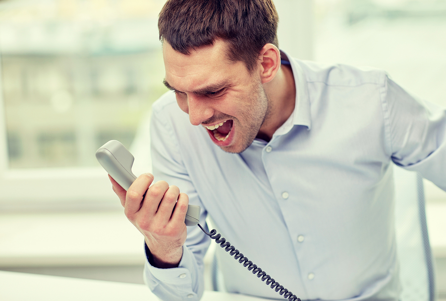 Businessman complains over the phone
